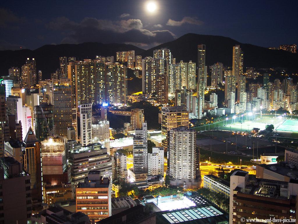 Full moon on buildings canopy in Hong Kong